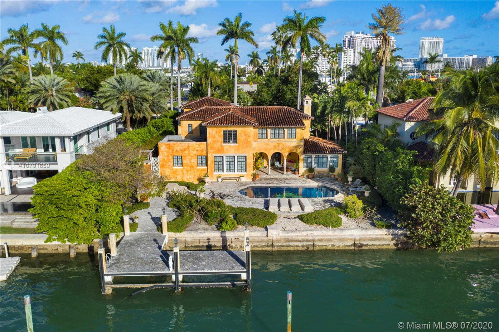 Located on the first of the Venetian Islands, Rivo Alto is walking distance to Sunset Harbor commercial district, parks and The Standard Hotel / Spa. This impeccably maintained Mediterranean Style home sits on an oversized 15,750 SqFt Lot with 90 ft of water frontage. Add your own touch to the current home through the possibility of an extension, build your dream home or enjoy its current layout at the price of the Land. The main house has 4 bedrooms 3 baths. The separate guest house contains a 1 bed / 1 bath ground floor suite + 2 car garage and a second floor 580 s/f 1 bed / 1 bath apartment with living room and kitchen. Per appraisal the total living area equal 4,899 SqFt.