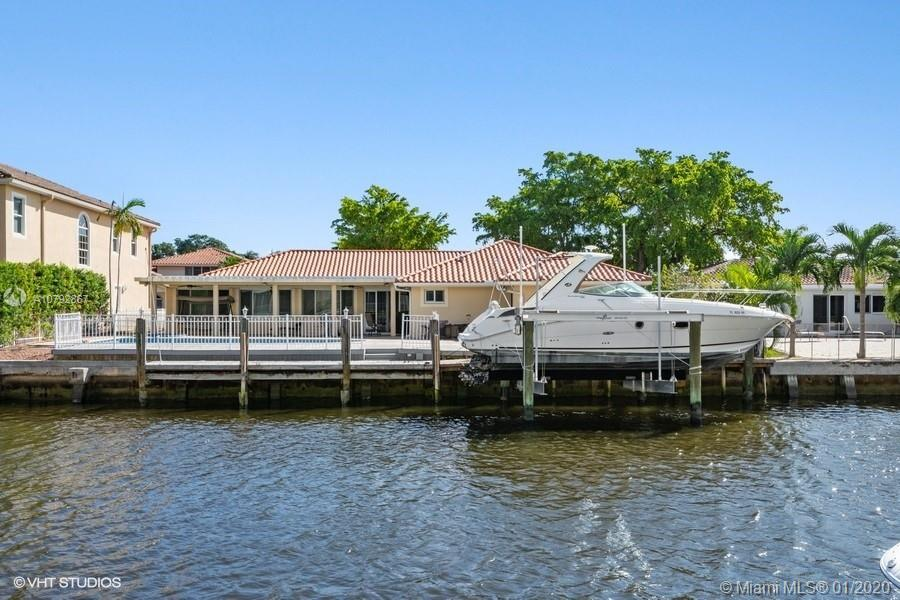 SOUTH FLORIDA LIVING AT ITS BEST! BOAT LOVER'S PARADISE- 85' FEET WATER FRONTAGE ON CANAL. QUICK