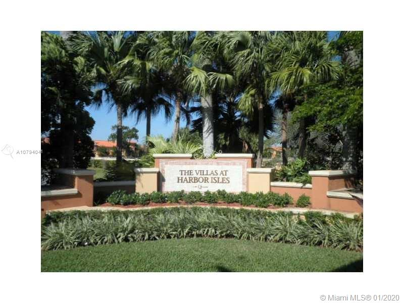 LARGEST 3 BEDROOMS / 2.5 BATHROOMS UNIT IN HARBOR ISLES, WATERFRONT FIDJI CORNER TOWNHOME WITH BREATHTAKING LAKE VIEW. GATED COMMUNITY BUILT IN 2006. LARGE LIVING ROOM AND FAMILY ROOM ON THE ENTIRE GROUND LEVEL, ALL TILED .UPSTAIRS SPACIOUS MASTER BEDROOM.PRIVATE PATIO, PLENTY OF PARKING SPACES,COMMUNITY POOL & TUB RESORT STYLE,KIDS PLAYGROUNDS, SECURITY 7/7. UNIQUE LOCATION CLOSE TO BEACHES, MALLS, FT LAUDERDALE, AIRPORT AND MUCH MORE. EASY ACCESS TO I-95 AND MAJOR HWYS.