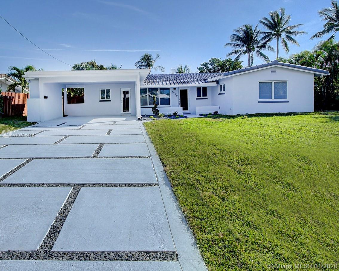 Stunning and completely renovated waterfront SFH in VERY sought out Coral Heights East of Federal Highway...just a bike ride away from the Beach. Spectacular kitchen featuring a 3D custom back splash, high-end gas stove and appliances, beautiful custom bathrooms, gorgeous porcelain floors, impact windows/doors throughout, long range wide canal views, stone column terrace, large yard with room for pool, gorgeous new custom driveway, 2013 roof & 2015 central AC. Priced way below comps. Prime opportunity that will not disappoint even the most demanding of buyers. Located in an absolutely beautiful neighborhood. Reasonable offers will be considered. Seller MAY contribute up to 10k toward buyer's closing cost! Agents please read broker remarks for offer and showing instructions. Thank you