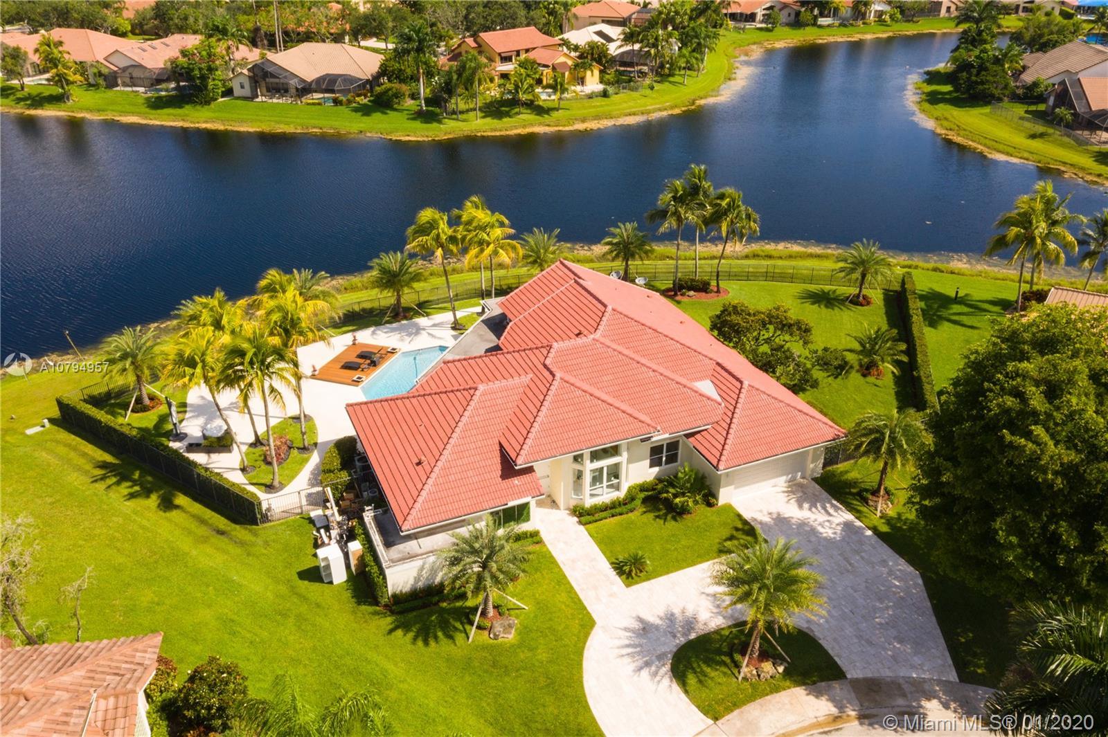 A BEAUTIFUL HOME FOR SALE IN TEQUESTA!! Come fall in love with this stunning ONE STORY, 4 BEDS 4  baths  home with a foyer entrance and 2 CARS GARAGE plus  circular drive. NEW  ROOF, NEW  APPLIANCES  as well as a large kitchen with an island modern layout. In addition, there is a beautiful FENCED yard  FRUIT TREES ,  POOL plus AMAZING  DECK  WITH  IMMACULATE LAKE VIEW.  The Tequesta GATED Community  is next to   paradaise Peace Mound Park. A+ School. READY TO MOVE IN!!!