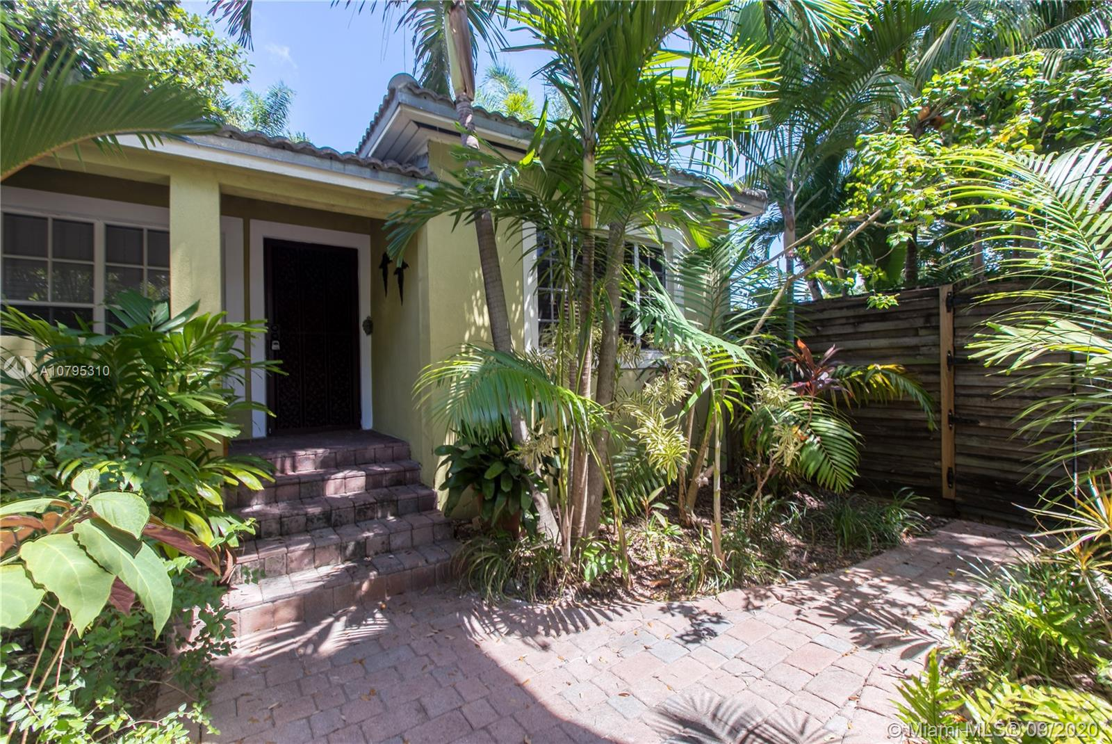 Charming Coconut Grove home located on a quiet dead-end street. 3 bedroom/2 bath; 7000 sqft lot with 2,022+ sqft of living space; larger than tax roll per seller.  Entertain next to a large 8' deep sparkling Salt Water swimming pool, surrounded by lush landscaping, a wrap around paver patio and courtyard with concrete shed. The location is ideal. Walking distance to the Biscayne Bay and area parks. Short drive to Brickell, Downtown, Coral Gables, South Miami and the University of Miami; easy access to the Palmetto Expressway and I-95. A must see; schedule a showing today.