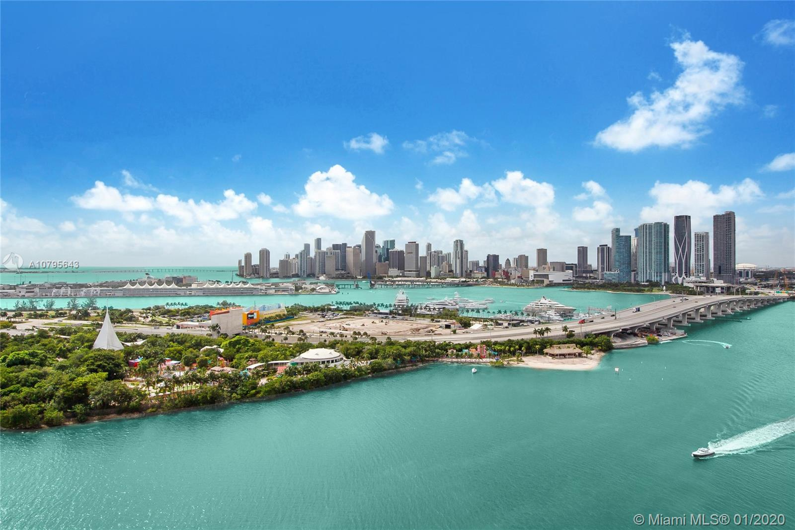 Panoramic views of Biscayne Bay & the Miami skyline from this rarely available penthouse at 1000 Venetian. This full-floor penthouse offers 4,276 sq/ft under A/C, surrounded by over 9 foot tall walls of glass doors leading to an additional 1,713 sq/ft of terrace space that is perfect for entertaining. (sq/ft per architect) The apartment has south, west & north exposures, with all rooms opening directly to the oversized terraces and unobstructed water views in every direction. The apartment was originally designed to be a 5bed/5.5bath but was redesigned into its current layout as a 2bed/3bath. This is a unique opportunity to own a large penthouse with the most amazing views in town, on the red-hot Venetian Islands! Easy to show.