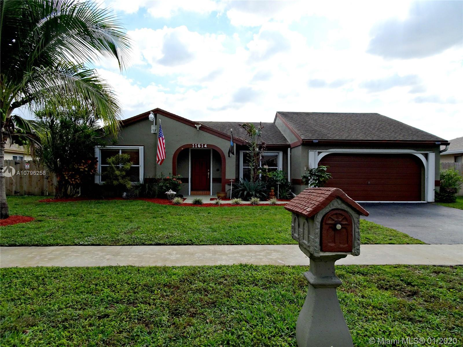 """OPEN THIS SATURDAY 2-4.  SUNDAYS OPEN CANCELLED.  Located in the A+ school system of Cooper City & the desirable Flamingo Gardens West neighborhood.Take notice of the gorgeous engineered cherry wood flooring that flows from rm to rm.Freshly painted interior in neutral colors & vaulted ceilings give an airy spacious feel.The living rm-dining rm lead to the kitchen with raised panel cabinets,SS appliances & granite counters.Off the kitchen is the family rm featuring a cedar wall & 65"""" LG TV & smaller flat screen that is wired to the security camera system (all included!)Split plan with 2 bedrms & an updated bathroom (tub/shower)& a large master en-suite with updated bathrm(TV stays).HUGE all seasons room (20x23)& fenced back yard with workshop/shed.Double gate and BOAT pad too!NO HOA!!!"""