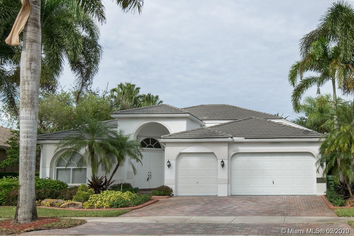 """An amazing Bright and spacious 5 Bedrooms /3 full baths in Luxury Gated Golf Community, Weston Hills CC, triple split plan, one story, lake front, fenced. Formal Dining, Formal living, Family room, New SS Appliances, Granite Countertops, 4bed FULLY FURNISHED, 3 Car Garage, Screened Pool. High ceilings,house was built in 1995. Bamboo floors and carpet on the bedrooms, ceramic throughout. Shopping, Dinning and Parks a few minutes away, """"A"""" rated Weston Schools. Won't last,Easy to show!"""