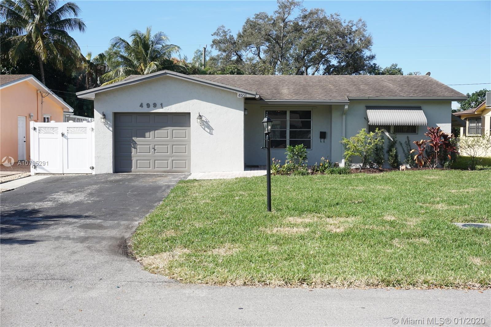 Excellent location! This cozy 3/2 home is situated in a quiet, family-oriented neighborhood. Located near I-95, 595, & the Turnpike. It's close to the beaches, the new Dania Pointe Center, Seminole Hardrock Casino, Ft. Lauderdale Airport, & a short walk to Patrick J. Meli Park. This house has everything you want! It has beautiful custom cabinets with plenty of storage space, granite countertop, & an open seating area. It's carpeted in the bedrooms, tiled throughout living areas, & it has a very spacious family room with view to the pool. A new roof with extended warranty was installed in 2007, a new 3.5 ton AC was installed in 2015, & it has PVC fencing. Play or grill around the huge yard or relax sunbathing & enjoying the pool. NO ASSOCIATION FEES!