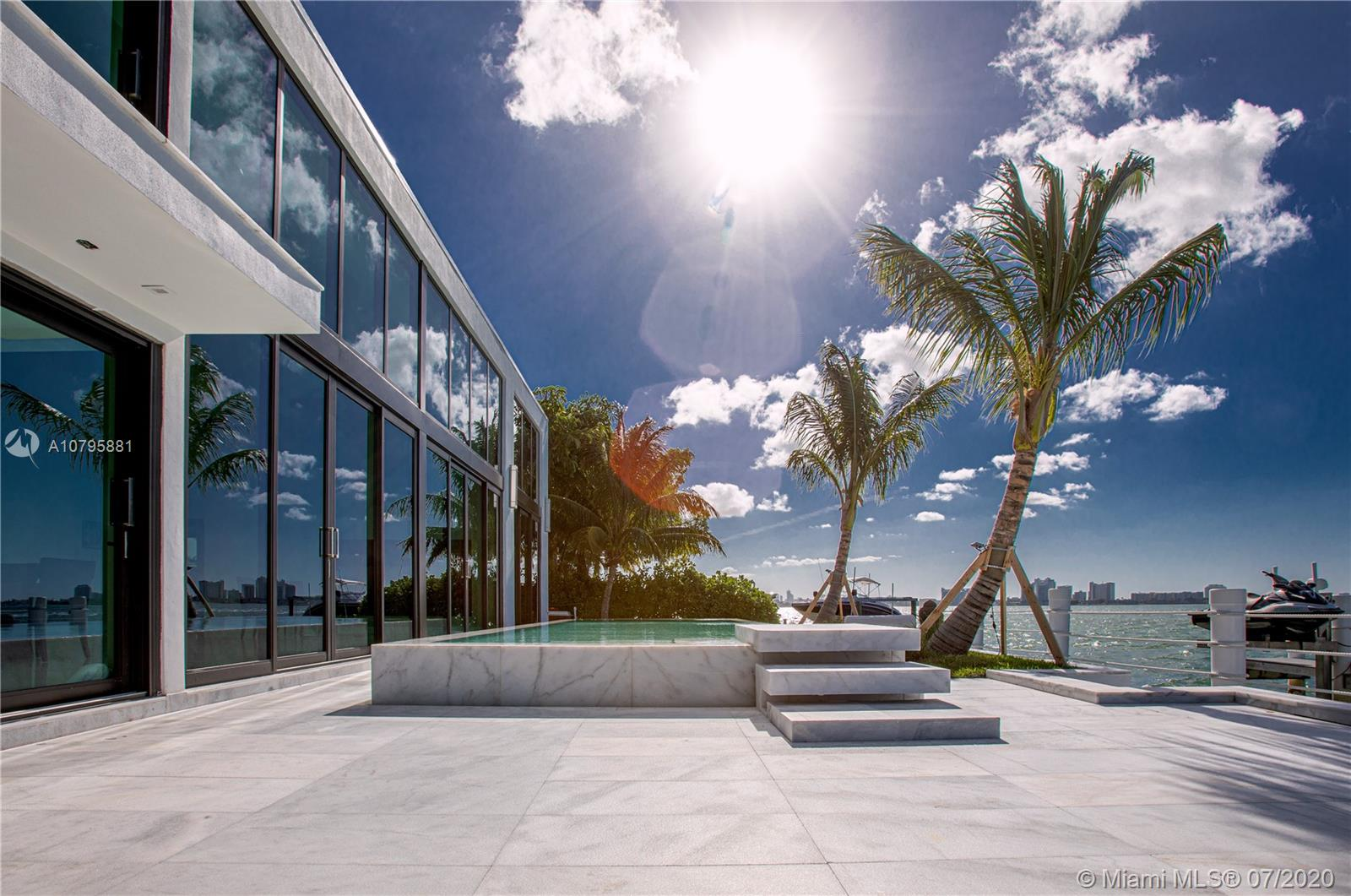 Extraordinary brand new 6,900 Sq Ft mansion located on the edge of the exclusive island gated community of Biscayne Point in M.B.This splendid home offers 22Ft ceiling living area with stunning views of Biscayne Bay. 5 bedroom 5 and 1/2 bathroom 7000 sqft home of pure luxury. Imported marble floors throughout the living area and beautiful oak wood flooring in all of the bedrooms. This home features 2 stunning master suites, the main floor suite is over 2,500 sqft with 20 ft floor to ceiling windows . The second suite on the 2nd floor offers extraordinary 15ft skylight ceiling for those who want to sleep under the stars. Custom Italian kitchen with tops appliances.This homes sites on a 12,000 sqft lot and 102 ft of Biscayne Bay frontage. Enjoy beautiful sunsets from your infinity edge pool.