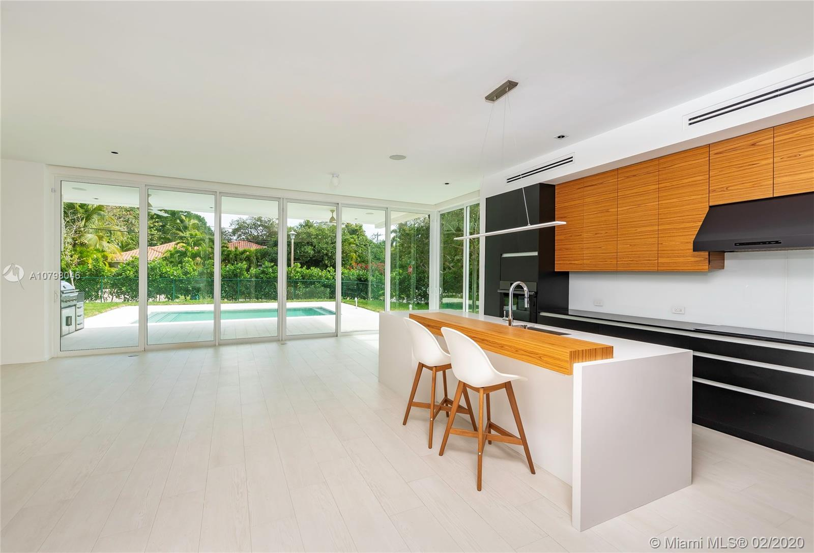 Spectacular contemporary modern new construction home in Coconut Grove. This one story house features an open floor plan with stunning entry w/ ultra high ceilings. There is an abundance of natural light with floor to ceiling sliding glass doors in the living areas, and porcelain floors throughout great room, dining and kitchen overlooking the wonderful outdoors. Enjoy the beautiful gourmet kitchen with high-end appliances and quartz countertops. The home sits on an 11,500sf corner lot. A modern terrace with outdoor summer kitchen and a comfortable extended entertainment area overlooks the pool.Floorplan features 3,455 Interior SF and total building 4,100 SF.EASY TO SHOW: Appointment through ShowingAssistance  SUPRA LOCKBOX