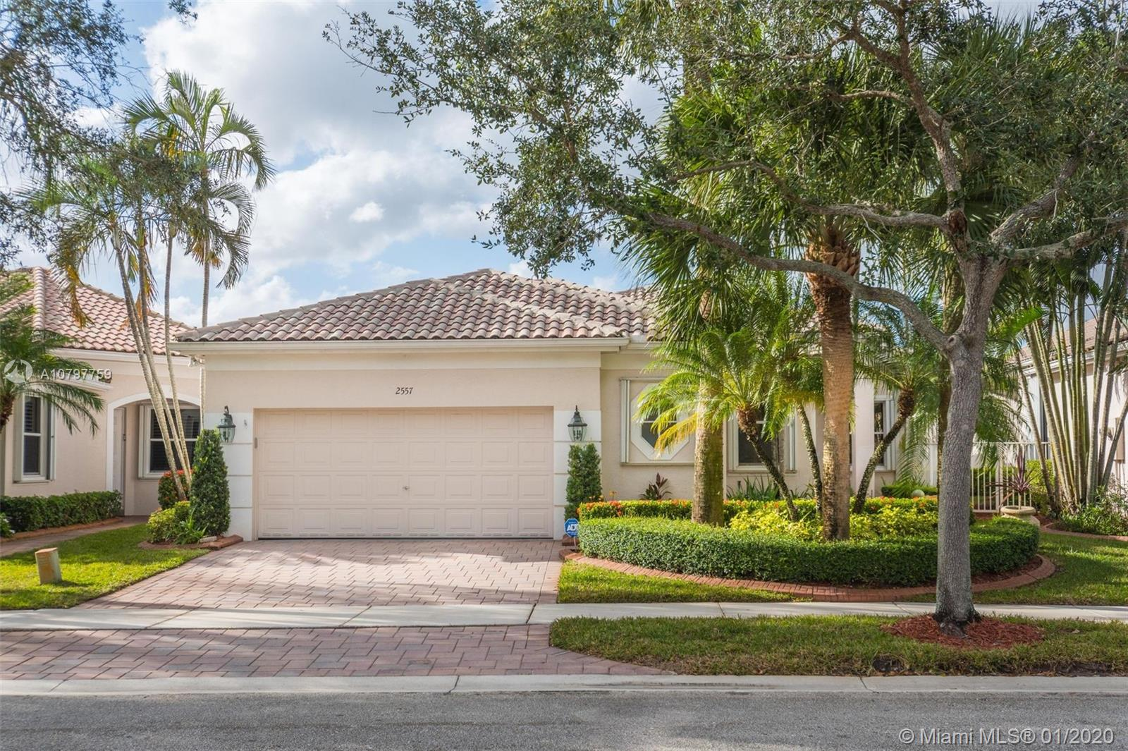 This spacious 3 bed/ 3 bath waterfront home in Bay Pointe - Weston Hills CC has it all. 3 bedroom is used as an office. Open floor plan with 14' ceilings. Custom kitchen with stainless steel appliances, granite counter tops, built-in bar w/ fridge, under cabinet lighting and more. Tile in the common area and porcelain wood-like tile in the bedrooms. Master bath has been completely updated with Maxx tub, walk-in shower with frameless glass, and his/her vanities. Plantation shutters. LED lighting. Enjoy incredible sunset views from your over-sized screened patio with large backyard (room for a pool). Accordian shutters throughout. 2-car garage. Fully maintained community including lawn/landscaping, fertilization, pressure cleaning & painting.