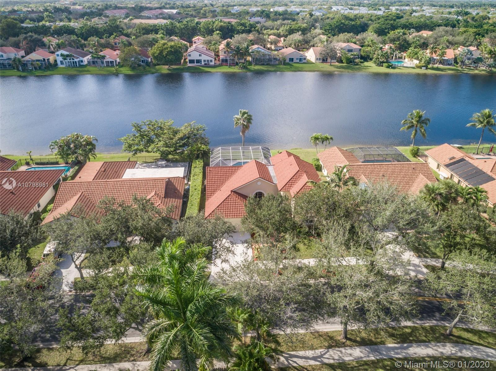This is the one you have been waiting for.Enjoy spectacular lake views from your screened patio and pool w new diamond bright 2018.Marble flows t/o the living areas with open concept living&high ceilings/windows on water.Renovated white kitchen w oversized granite countertops, stone backsplash, Stainless steel appliances, pull outs, soft close cabinets, Lazy Susan, under cabinet lighting, integrated wine rack/ matching cabinetry in pantry/laundry room.Stainless steel appliances/Kitchen Aid.Master bedroom on first floor w access to patio/pool. Volume ceilings&plush carpet. Master bath w roman tub, dual sinks, shower & cabana door to patio.Secondary baths renovated with marble and seamless shower.Additional bedroom*den on first level.Second floor boasts two more spacious bedrooms plus bath.