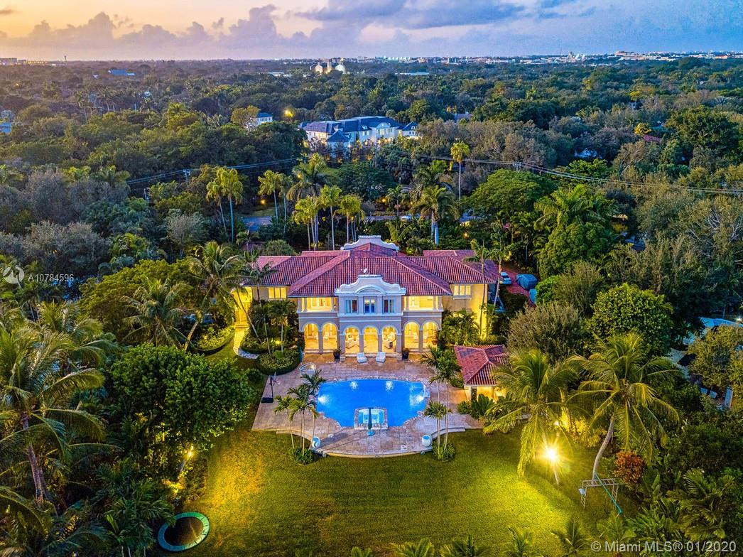 On a 45,738 SF lakefront lot sits a stunning 8909 SF Mediterranean-type home. This special home is located in the sought after, private gated community of Hammock Lakes. With breathtaking views of the tranquil lake as soon as you walk into the foyer. Stunning custom-built house with 6BD/7.5BA, gorgeous pool, summer kitchen, cabana, private dock, children's play area, terrace, 3-car garage. Other amazing finishes include surround sound throughout & Lutron lighting system.  *Chandeliers not included