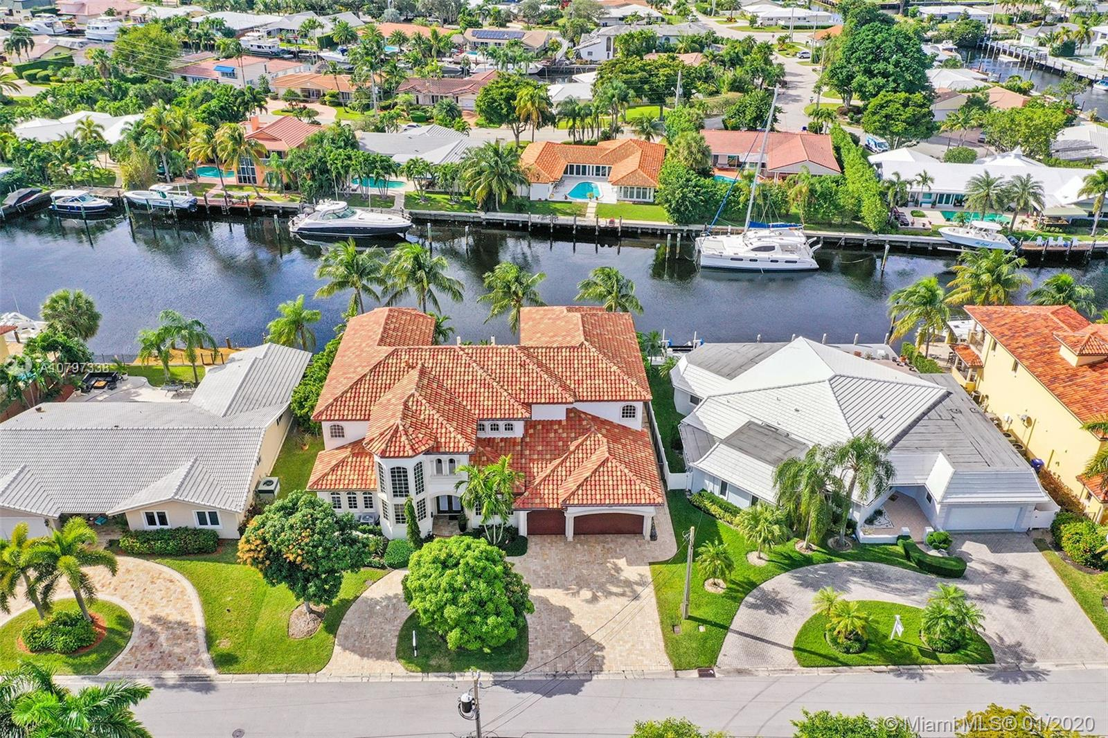 """MAGNIFICENT OCEAN ACCESS POOL HOME IN A HIDDEN POCKET OF EAST FORT LAUDERDALE CALLED """"THE LANDINGS."""" This custom built home with soaring high ceilings and panoramic water views is nothing short of impressive! 5 bedrooms/5 baths(2/2 downstairs and 3/3 upstairs)Enough room for the family, guests, and the Gatspy party! This one has it all including all impact windows and doors, Wolf Appliances, Marble counters and floors throughout, outdoor kitchen, 85 Ft of water front, full home generator, elevator, theater room, boat lift, covered loggia & private balconies add to this fine estate. Exceptional location for boaters as the canal is 140 FT wide and on a dead end perfect for turning any size vessel...and its 1 minute from Intracoastal and 0 boat traffic!!Literally a Steal!Fit a 75FT Yacht!"""