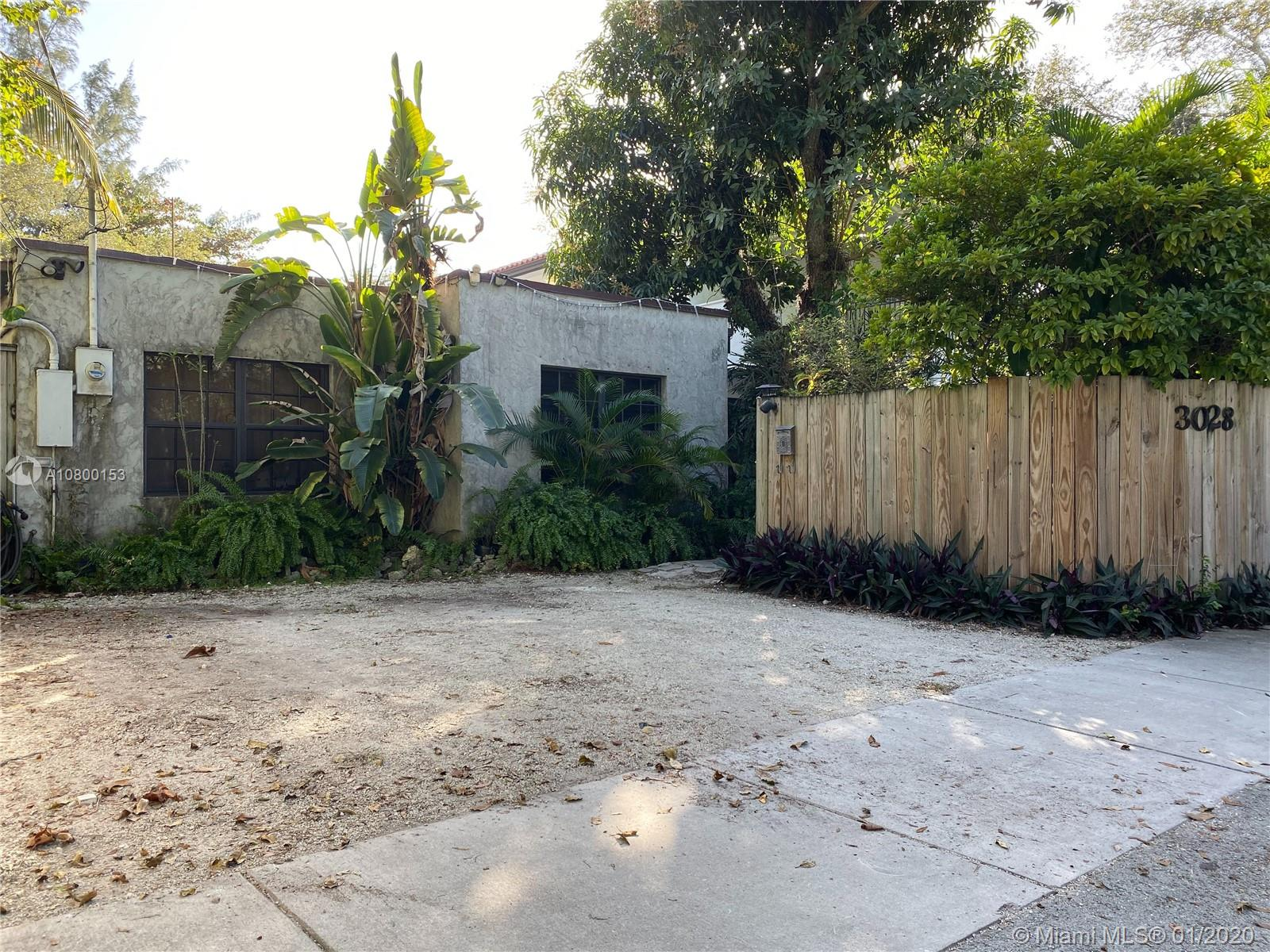 This unique property in the heart of the grove has great opportunity. Situate yourself directly across Blanche Park which offers a fully renovated dog and children's park. This property features a one of a kind, custom, grotto style swimming pool. The property is walking distance to retail, restaurants, and much more! Zoned for duplex.