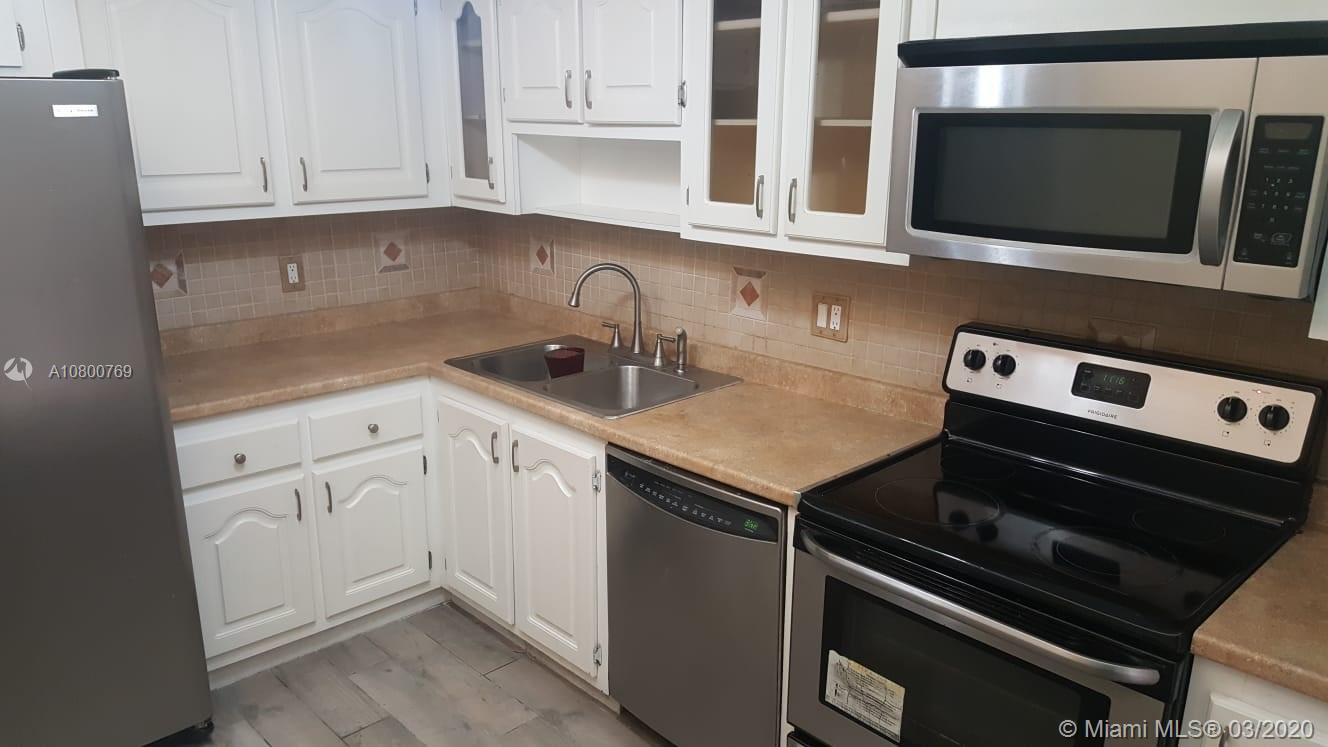 Beautiful first floor corner condo. 1289 SF. 2/2 Screen patio. Assigned parking. Golf course and Lake view from unit. Italian Porcelin Tile floors throughout. Stainless Steel appliances, dishwasher, microwave. Newer A/C Unit!. No petsWater, Cable, and Internet Included. After only 1 year, unit can be rented.10% down required