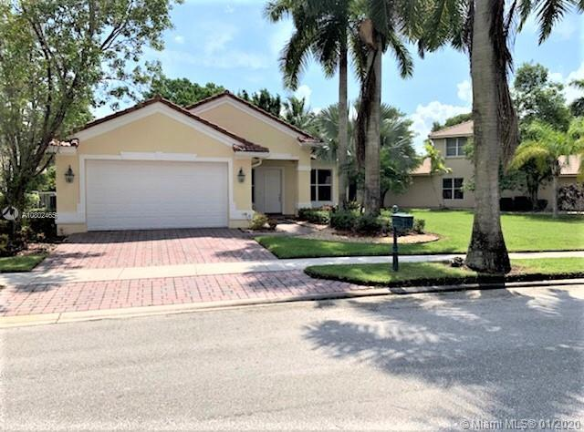 Gorgeous home in desirable Weston Hills Country Club. Enjoy spacious 1 story home 4 bedrooms, 3 bathrooms, split floor plan, beautiful and upgrade open kitchen, granite counter tops, SS appliances, bathrooms tastefully updated. Laminated wood floors. Corner large lot. A+ rated schools.