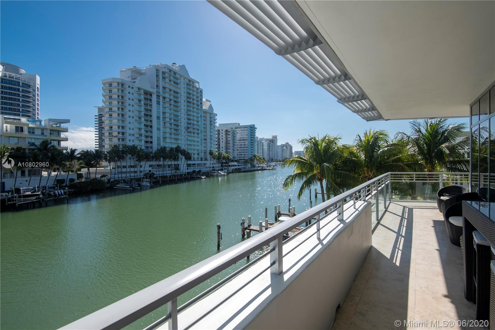 White, Modern, Fresh, Crisp, Clean!  Welcome to Aqua' most sought after 01 line at the Prestigious Gorlin Building.  Known for its 10 ft ceilings with wraparound balconies showcasing gorgeous views of Miami Beach's Intercoastal Waterway, this modern 3 BR 3.5 BA apt delights in every direction. Modern walls of glass encase the sun-drenched spacious living room, while swaying Palm trees & glistening blue-green water provide the exterior backdrop, and Crystal White 24 x 24 Marble floors complete the look. Enjoy a large open Bulthaup kitchen with extensive grey/white marbled countertops, high-end appliances, Carrera marble bathrooms, white vanities, a jetted tub & custom closets. Aqua is a private 8.5 acre island community w/24 hr guard gated security, 2 pools & a state of the art gym/spa.
