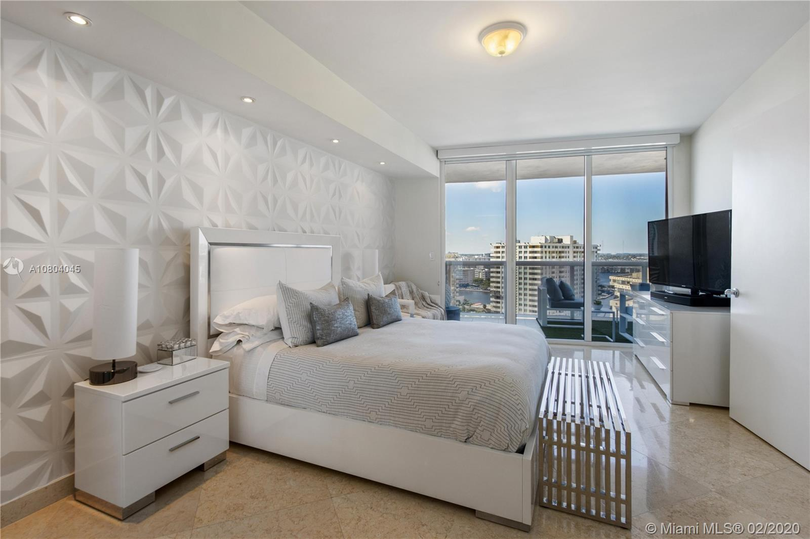 Breathtaking intracoastal and city views awaits you from this 1 bed + den / 1 bath. 1086 Sq Ft unit with a 195 Sq. Ft. Balcony. Marble floors, located directly on the ocean, building features a 40,000 sq. ft. full service spa & fitness center, restaurant, bar with pool service features a 40,000 sq ft. full service spa & fitness center, restaurant, bar with pool service, 24 hr. valet parking and security. It includes a 9 acre with 810 ft. of ocean frontage.