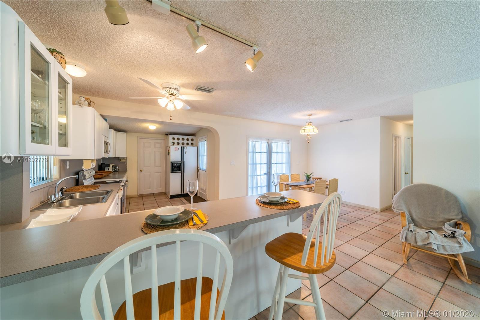 Great opportunity-own this 3 bed/3 bath home w/pool in a large lot in a quiet Cutler Bay street. This home has a great floorplan with tile floors in living areas and lots of natural light. French doors open to the patio/pool area.The open kitchen has a long counter-top (18 ft), eat-in counter/bar, white-formica cabinets in great shape-like new.  The oversize backyard offers plenty of room to entertain, the pool measures  24 ft x 12 ft and the great shaded-gathering area under the tiki hut with hammock is all you need to relax.This home also has a new shingle roof from 2018 and includes a large shed for all the men's toys & tools which measures 21 ft x 8 ft.Some updates will make this the perfect home for you. Close to many schools, shopping, restaurants, US-1 and Turnpike. No HOA.