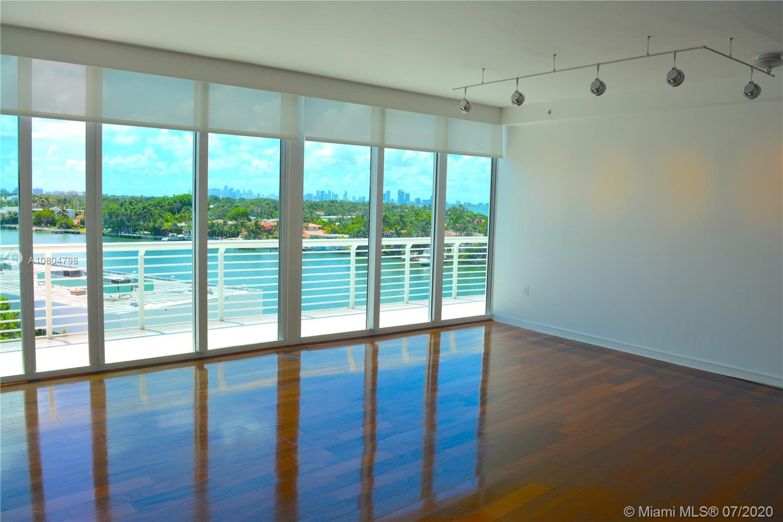 Excellent price for a stunning 1788 SF, 3 bed/3bath Penthouse, with gorgeous intracoastal, bay, ocean, and Miami skyline views at Regatta in Miami Beach. Contemporary, stylish interior, with balcony off the main living area and a private rooftop terrace with whirlpool tub and shower accessed from within the PH. Upscale open kitchen, marble baths, wood and marble floors, modern lighting, high ceilings, impact glass, walk in closet, 2 parking spaces, and glorious sunsets. Main level living area, kitchen, and bedrooms in pristine condition, brand new jacuzzi deck on the rooftop terrace. The 52 unit Regatta enjoys a waters edge pool, whirlpool, gym, concierge, and 9 slip marina. Ideally located midway between South Beach and Bal Harbour, just steps from the beach. Ready for occupancy!