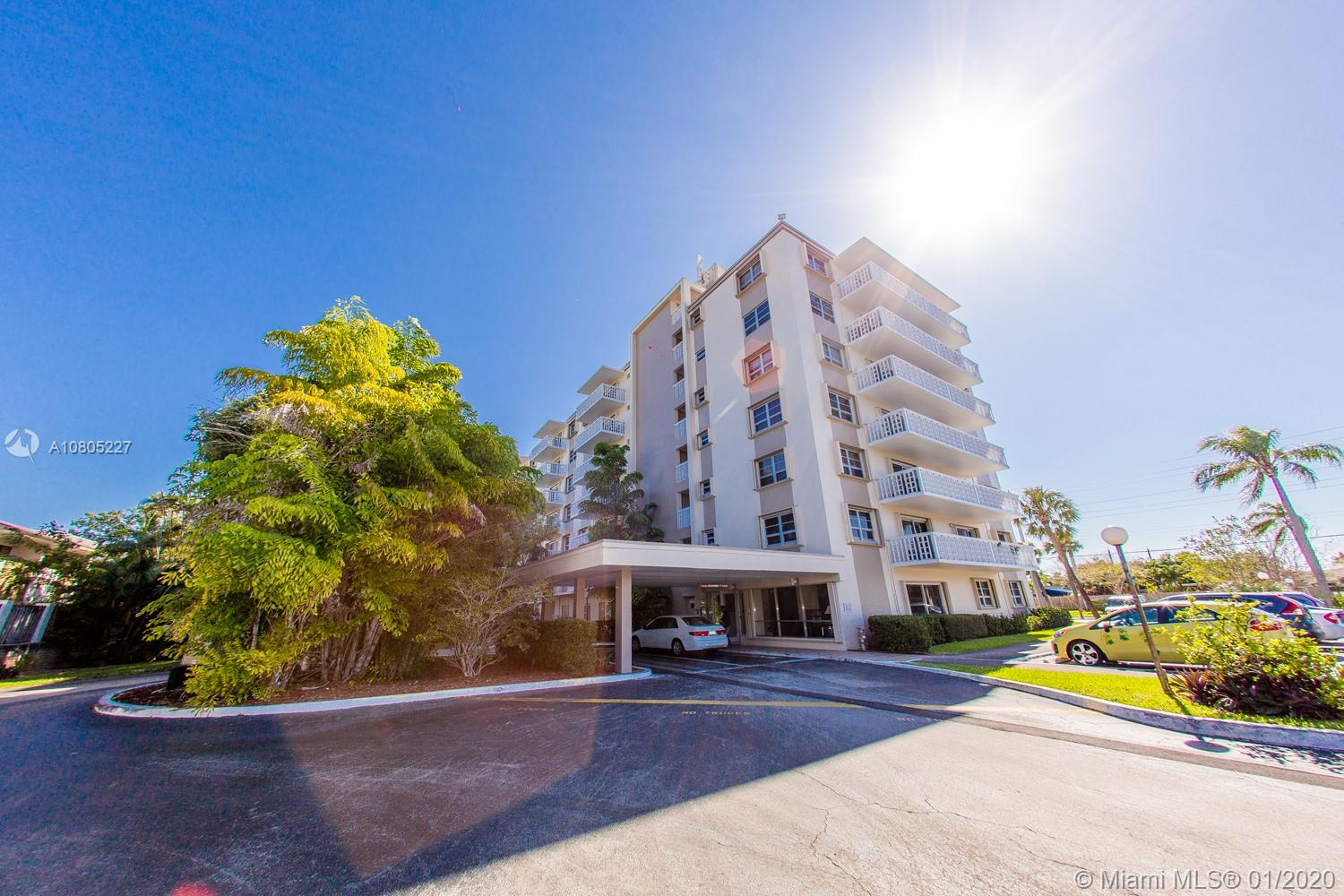 Renovated condo with beautiful city views is ready to move in! Property features redone kitchen and baths, laminate wood and tile floors, top floor with open balcony and so much more. Make this your home today!
