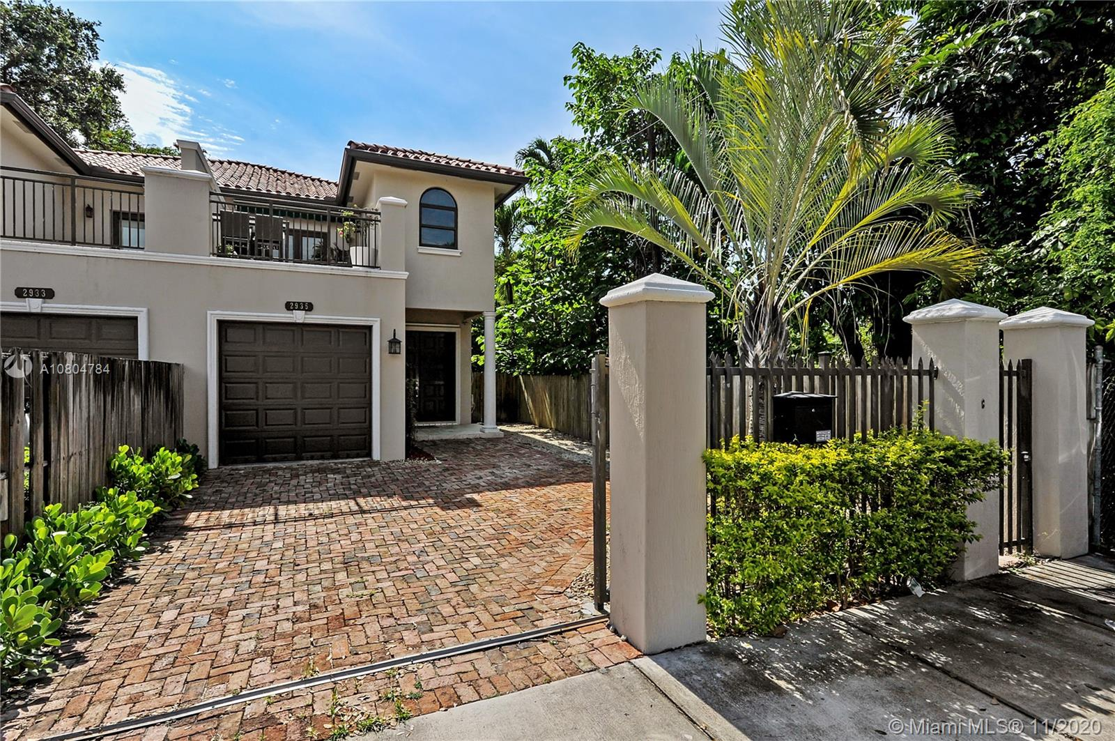Gorgeous luxury Townhome elegantly located in the village of Coconut Grove. This 3 Bed 2.5 Bath home features a private electric gate entrance, one car garage, saturnia marble floors through-out, and high impact windows. 3 bedrooms upstairs including laundry facility and large master suite with balcony, perfect for evening sunsets. Downstairs you will find spacious common areas boasting 10' ceilings and well situated windows facilitating plenty of natural lighting. Step outback to the private covered terrace and jacuzzi/spa surrounded by beautiful Chicago brick.