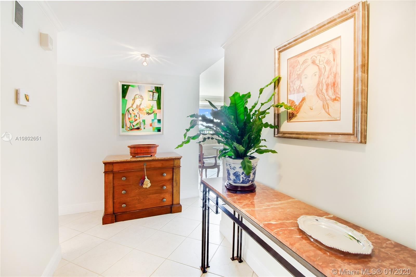 South Side Unit With Panoramic Ocean, Island, Bay, Pool, Fountain & Sunset Views!  Immaculate interior features, tile floors throughout, an open kitchen with white cabinetry, stainless steel appliances and white marble counter tops/backsplash. Large Terrace! Plenty Of Light & Sunshine!
