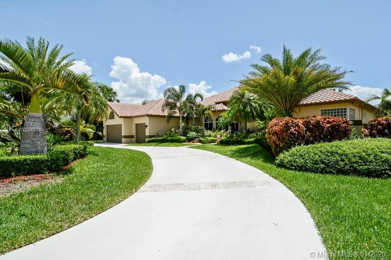 Fully upgraded pool home in the secluded, double gated community of PALM ISLAND in Weston. This spacious one story high ceiling, 4 bedrooms, 4.5 bath, 3 car garage with circular drive way has been totally remodeled with over $450K in upgrades & high end finishes: PGT Impact windows, new ROOF, new AC's with ducts, CREMA MARFIL MARBLE through out the house. New fully renovated bathrooms with glass door showers, GORGEOUS CHEF KITCHEN with custom 54' wood soft close cabinets, monogram appliances, warmer, double oven & induction cook top. The Private fully fenced backyard shows as paradise featuring NEW RESORT STYLE POOL with waterfall, travertine floors and lushly landscape. Best schools in Weston including Cypress High.