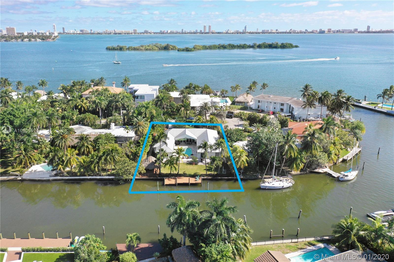 """Belle Meade Island""  103' of deep Waterfront dockage. Only 3 Lots of the Wide Bay !!! Oversized 1/3 Acre Lot on a Private ""Cul-De-Sac"" Peninsula. 5 Bdr 4Bth 4400 SF 2 Car Garage Pool. Walk into Beautiful Hi Vaulted Ceilings Classic 1960's ""A"" Frame Construction, All Glass surrounding the Pool  ""Lots of Light"" All Rooms open to Pool and Backyard. Remodeled Throughout. Large Center Island Gourmet Gas Kitchen, with Sub-Zero and Wolf Appliances. All Marble Flooring, Porcelain and Marble Baths. Huge Master Suite w/sitting room, features huge walk in closet, a Large Bath with Floating Tub and separate Shower Stall. Tropical Landscaped Large Backyard (Lots of yard space to Entertain and play in) with Chickee Hut and Oversized Dock. 24 hour Guard gated Community."