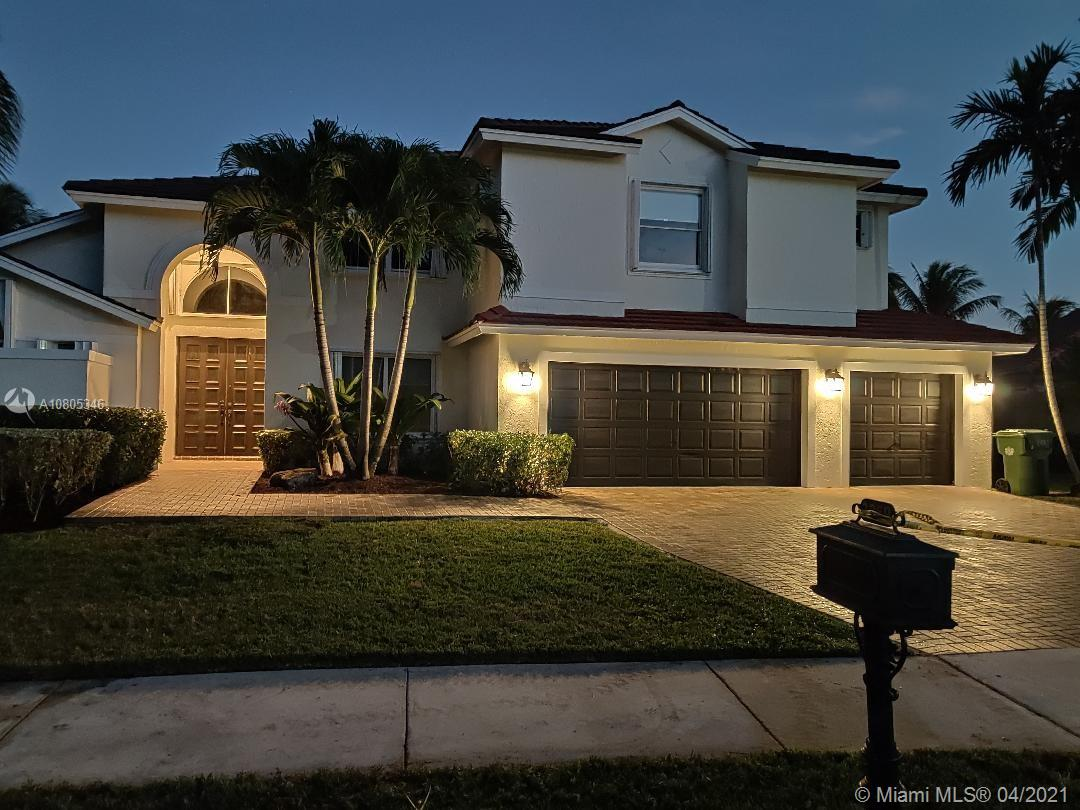 """Price drastically reduced! 10% below the original price!Great home located in the prestigious """"Huntington"""" in Weston Hills. Cul de Sac, beautiful lake view, pool, 3 garages, anti-hurricane shutters on all windows, large rooms, master bathroom with two sinks, shower and Roman bathtub. Marble floors, LED lighting, deck with covered area, recently remodeled, social area with double height ceilings, Hunter Douglas roller solar shades and blackouts. Roof recently updated. Interior and exterior freshly painted. Don't buy without seeing this magnificent property."""