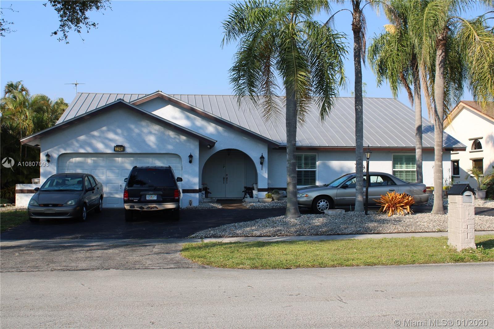 No HOA. New metal roof & metal fascia, new ac, new hurricane tinted windows, new copper pipes, upgraded insulation & wiring, new electrical box, screened pool & hot tub, electrical box for generator for entire house has been installed, tv antenna installed, fenced back yard with addl fenced dog run, security system, 2 car garage with circular drive, shed in backyard, plantation/bahama shutters on windows/doors, vaulted ceilings, ss appliances, security system, huge closets. Pantry has it's own room! Full living room, dining room and family room. Fabulous location just east of university & commercial blvd.