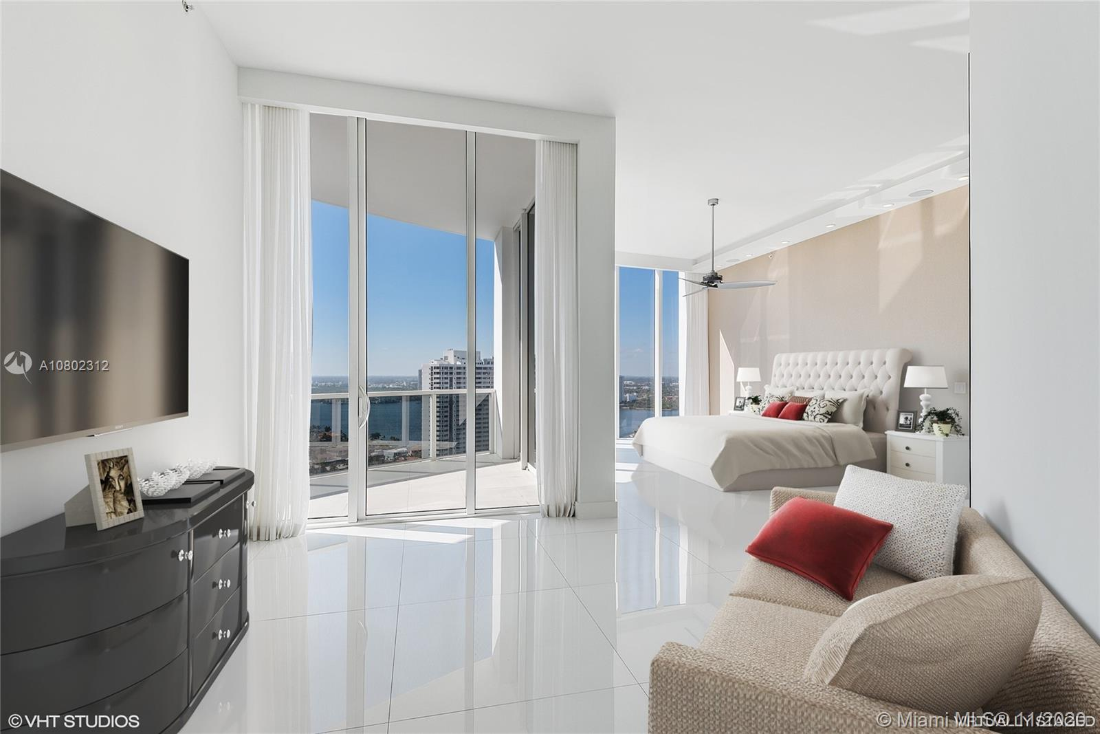 REDUCED!  Open the door to the most spectacular views Miami has to offer.  12' floor to ceiling impact glass and an open wraparound balcony floods the unit with natural light.  The large master bedroom has dual master baths, walk-in custom closets, electric blinds and a sitting area.  The over-the-top chef's kitchen has Miele appliances, induction cooktop, coffee/espresso maker, dual wall ovens & wine cooler.  Sonos surround sound in all rooms, plus custom lighting.  Private entrance to Office, Den, Nanny or Maid's room, your choice. Unit comes with two assigned parking spaces and two storage units.  Williams Island offers full concierge service, valet, fitness, spa, salon, 16 tennis courts, pool, marina, children's park, dog park and 3 restaurants. $10,800 CREDIT TO BUYER FOR ANNUAL FEES!