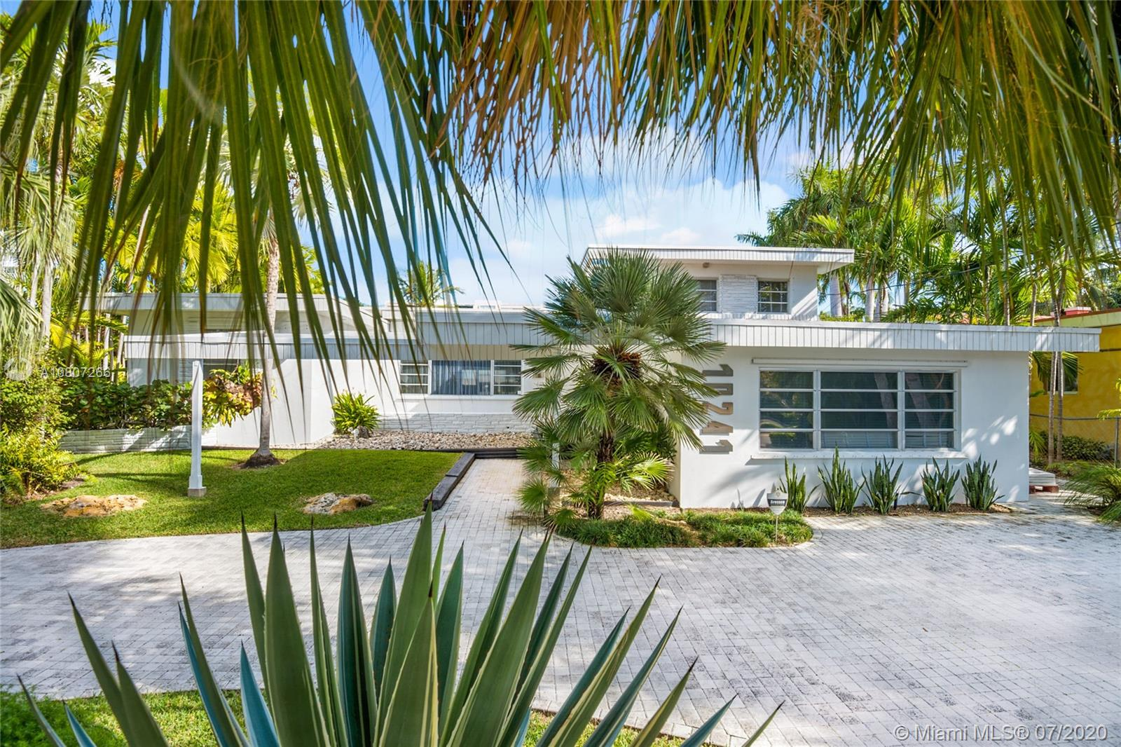 Bay Harbor Islands Mid-Century waterfront home w 1950's style & allure. Situated on the far north side of the island, this iconic residence is 3 lots from the open waters of Biscayne Bay- offering direct ocean access, within minutes. Upon entering the house, you will find seamless terrazzo floors (in mint condition), original architectural features & amazing distribution of space w/ an open floor plan. 5 bd/4 full baths + nanny's rm. The seawall/cap/dock (75' on the water) were completed in 2015 w/ refinished pool/lounge area. Impeccably designed kitchen redone in 2015 w/ all Viking gas appliances. Separate master bdrm, offering privacy & views of the water. Waterfront living at it's best! A-rated schools, walk to beach, Bal Harbour Shops, & houses of worship. Over 3700 sq ft as per owner.