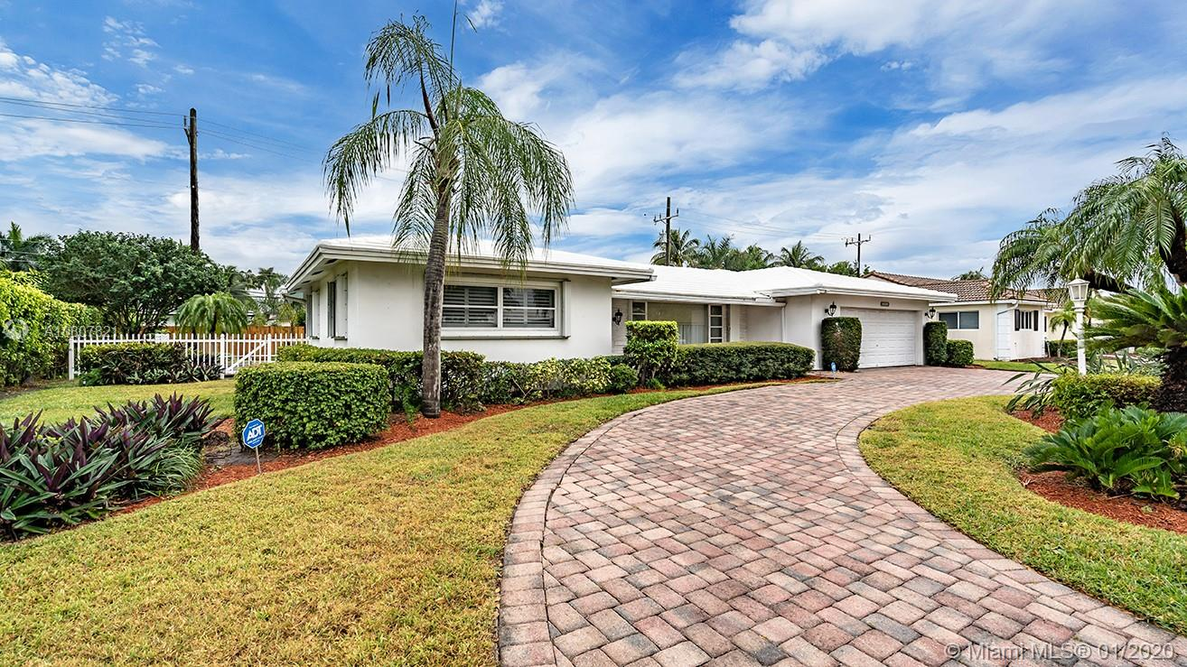 Beautiful 3/2.5 pool home is ready for your personal touch! Fabulous Fort Lauderdale location close to Coral Ridge Country Club, intracoastal, beaches, Cardinal Gibbons High School, Holy Cross Hospital and so much more. Property features pavered, circular driveway, large pool, fenced yard, redone master bathroom, ceramic tile, laminate wood and carpet floors, spacious kitchen and so much more. Make this your home today!
