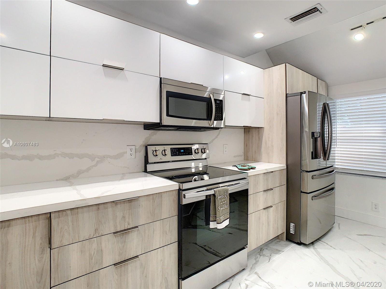 FULLY REMODELED 2 BED 2.5 BATH TOWNHOME NEAR LAS OLAS, THE BEACH & FLL AIRPORT. SMALL GATED COMMUNITY. PORCELAIN 24X48 & LAMINATE FLOORS THROUGHOUT.  EUROPEAN STYLE STAINLESS STEEL APPLIANCES & QUARTZ COUNTERTOP.  LAUNDRY ROOM, FENCED PATIO FOR ENTERTAINMENT, 2 ASSIGNED PARKING SPACES & MUCH MORE.
