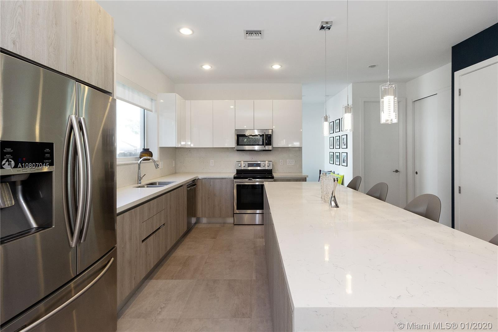 Walk to Las Olas Blvd from this '16 gorgeous Tarpon River Certified Smart Home. METAL ROOF, Spacious Open Floorplan, High Ceilings, & Tons of Natural Light from the IMPACT WINDOWS. High End finishes: Porcelanosa porcelain flooring & cabinetry throughout, LED Fixtures, High End Custom Closets & Solar Roller Shades. Fenced & Landscaped Backyard w/ Black Bamboo & Artificial Turf! Wifi Garage, Alarm, Nest & Ring. NO HOA! Tarpon River is Ft. Lauderdale's new hot spot walking distance to trendy new Restaurants (The Grind, Tarpon River Brewing, Hardy Park Bistro) & Hardy Park Tennis / Playground & new South Side Cultural Arts Center! Close to Downtown, Sea & Airport, Beach, I95! Builder's blueprints attached show larger sq ft than in MLS. Liv Area: 2378; Tot Area: 3232. Buyers may verify.