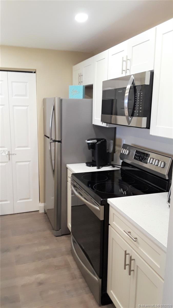 Truly a gem!!!!  Completely remodeled in 2019. This 6th floor condo in desirable Island Club is sure to please. Updates include updated kitchen cabinets, Quartz counter tops, stainless steel appliances, laminate floor throughout, 2 remodeled bathrooms with walk in showers, huge pantry closet, and upgraded electrical panel.  Community proudly offers two heated swimming pools, sauna, hot tub, billiard room, function hall, card room, 24 hour manned security, courtesy bus, etc. Close to beaches, shopping, dining, and golfing.Must own 2 years prior to renting.