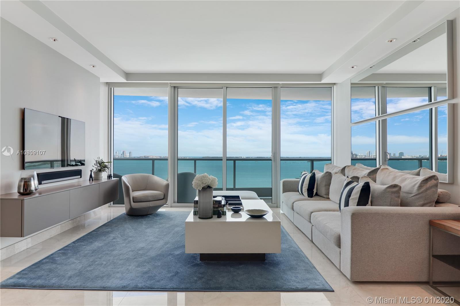 Enjoy stunning sunrises and endless vistas from this picture-perfect residence. Be welcomed to a private foyer via private elevator that opens to an ample and unique space with unobstructed views of Biscayne Bay, Miami Beach, and beyond. Every aspect of this unit has been carefully thought out and meticulously configured to accommodate a family of 4+ or as second/vacation home. All rooms were recently updated with smart and elegant touches to enhance their comfort and maximize their use. The bathrooms were tastefully refreshed to the specs of a five-stars hotel. New interior doors were installed to amplify the volume of flow of the unit. A designer lighting package was also added to improve the ambiance, and a built-in Murphy bed in the den allows for overnight guests.