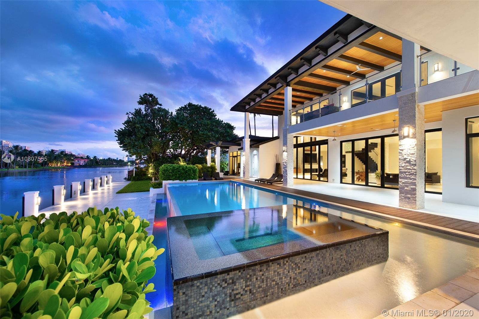New  Built Waterfront Estate in Hollywood  to the highest construction standards. Privately gated , the approach to the home is grand,lush landscaping  with a spacious deck,boat lift , Infinity pool, spillover spa and fire pit  provide year -round entertainment. With 150 feet of dockable frontage on a 120 ft deep canal. This property boosts access to the Atlantic ocean.A smart home with  a elegant interior  features touches from stone accents to glass stairs and private elevator .Gourmet kitchen, expansive master bedroom with  split master bath. This property features 5 large bedrooms with 5 bathrooms and a half. Hollywood Golf Estates is a cozy enclave of contemporary homes  epitomizing the South Florida  lifestyle .