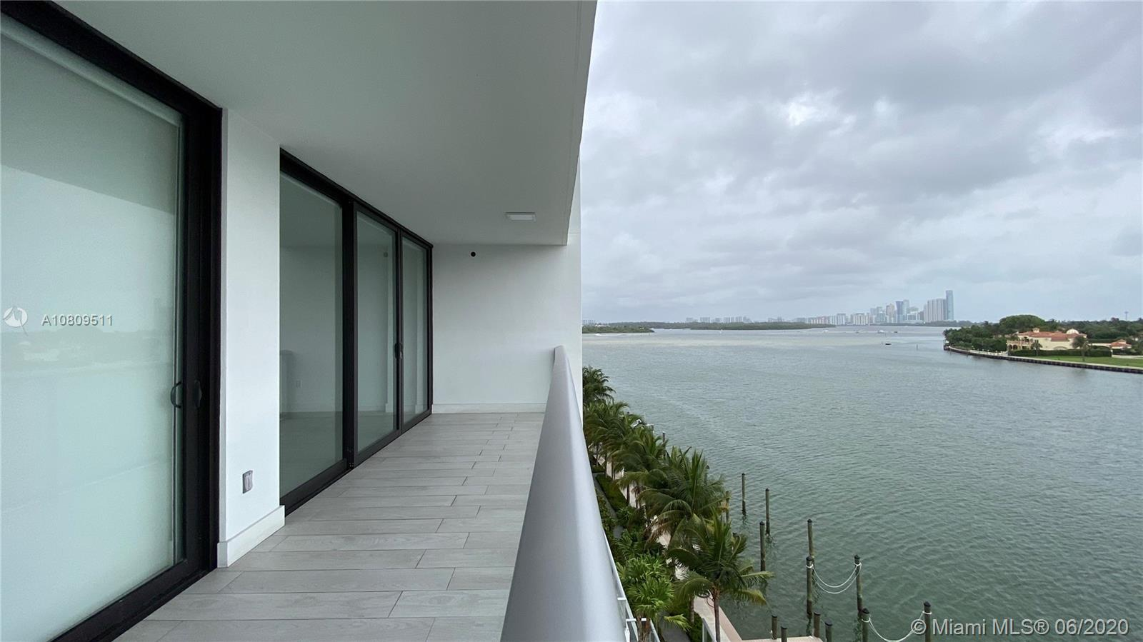 Amazing 1 Plus DEN with 2 complete Bathrooms, incredible Master Suite with modern custom closets and electric windows treatment, Den room is closed with bathroom and closet inside, Boutique Modern Building located in a Island on the bay, just steps from the beach, restaurant and shopping Mall at Bal Harbour, amazing bay views, In & Out Building Boat Dock (Association Restrictions Apply) 2 assigned parking spaces + STORAGE. Porcelanato floors inside and on the balcony. Electric blinds on Living room also.