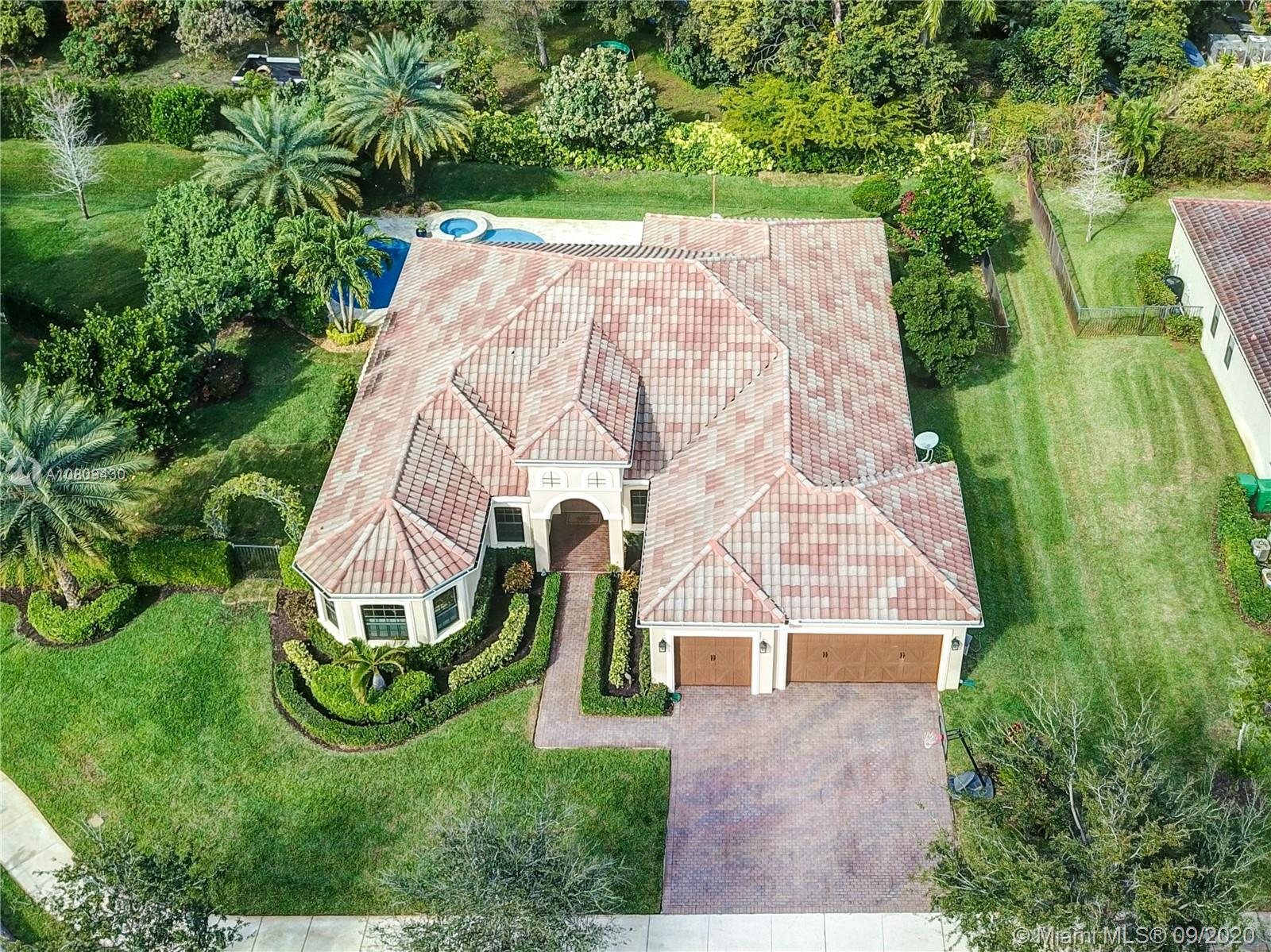"""RARE OPPORTUNITY in coveted Cooper City!!!  This TURN-KEY estate home of 5bd, 3br sits in the exclusive community of The Ranches.  Home sits on a 1/2 acre cul de sac lot and offers state of the art kitchen with TWO dishwashers, stone fireplace, tray ceilings, crown moldings, impact doors and windows and """"smart home"""" features. Backyard PARADISE:  with over 100K spent on  landscaping (fruit trees) and the resort style salt water pool with LED lighting, stone accents, a sun deck, travertine pool deck, all controlled from your smart phone.  Cooper City Schools!"""
