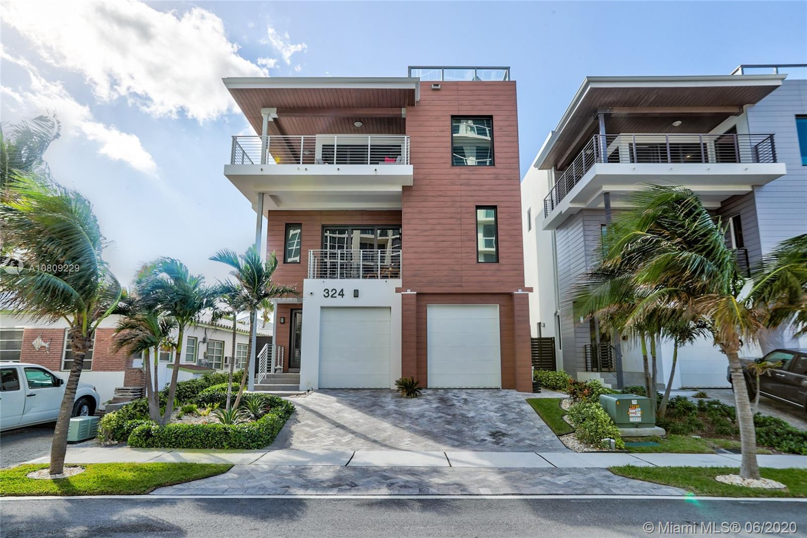 Make the beach your backyard!! Contemporary Modern Tri-Level beach home, DIRECT OCEAN VIEWS, steps from ocean, 3153 sq ft, 4 BR, 3.5 BA, Master Suite, his & her walk-in closets, beautiful en suite, stunning finishes, Armadi custom cabinetry in all closets, Hunter Douglas automated window treatments in all rooms, volume ceilings, Sonos sound system, integrated smart home features, 3rd level open floor plan showcases ocean views from floor to ceiling windows, Gourmet Kitchen, professional Sub Zero Refrigerator/Freezer, Thermador gas range/hood, Italian Venetta Cucina cabinetry, rooftop terrace w/ spectacular views of the Atlantic, summer kitchen, elevator access to all floors including rooftop, 2 car garage, close proximity to airport and interstate, this turn key home is move-in ready!!!