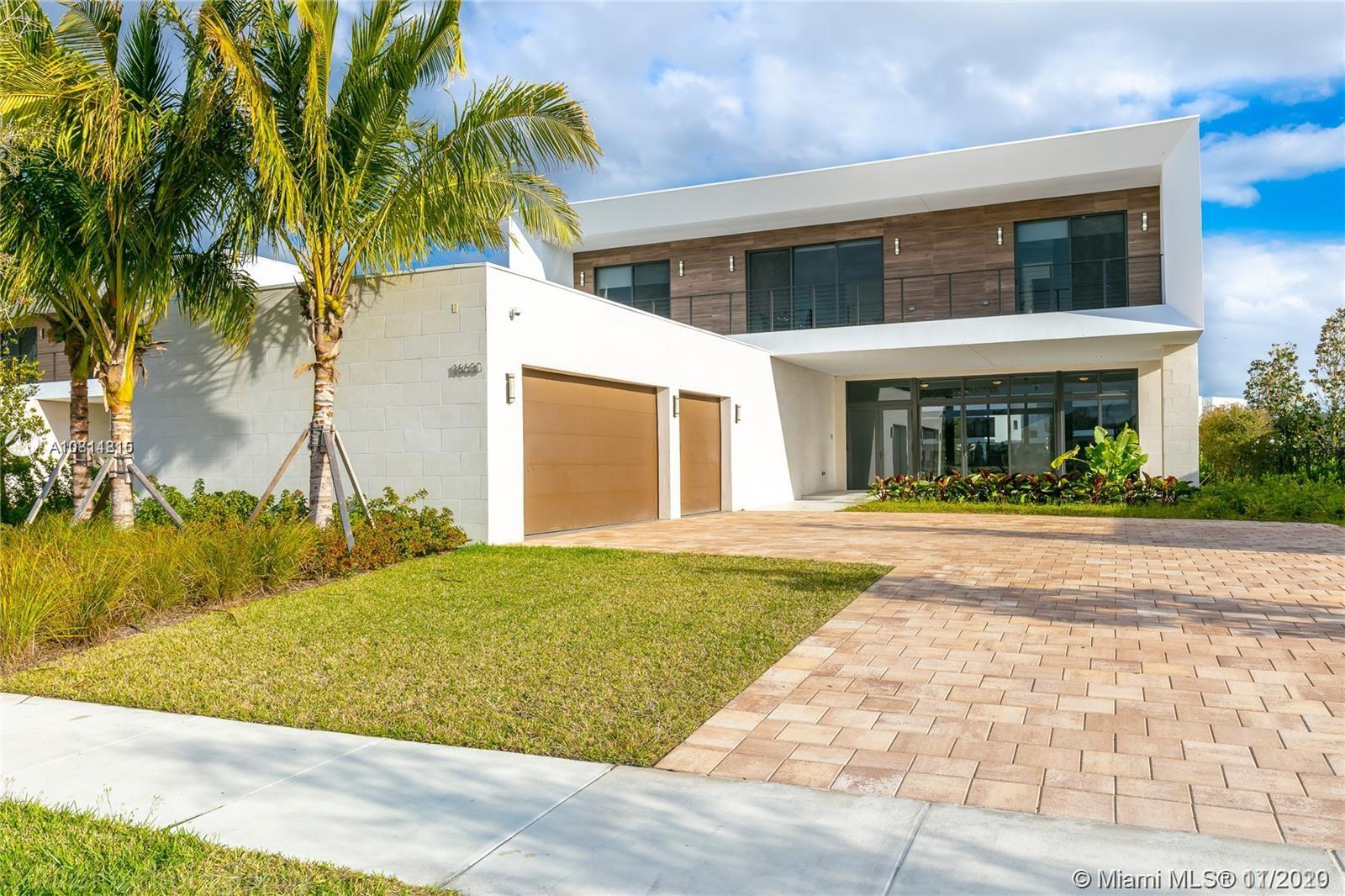 ABSOLUTELY STUNNING!!! CUSTOM BUILT HOME IN A SPECTACULAR MODERN SUBDIVISION: 5 BEDROOMS, 6/1 BATHROOMS PLUS AN OFFICE, MANY UPGRADES WITH WATER VIEWS. KITCHEN WITH AN ISLAND, WHITE CABINETS AND SUBZERO FRIDGE. MOTORIZED. THIS HOME IS A MUST SEE!