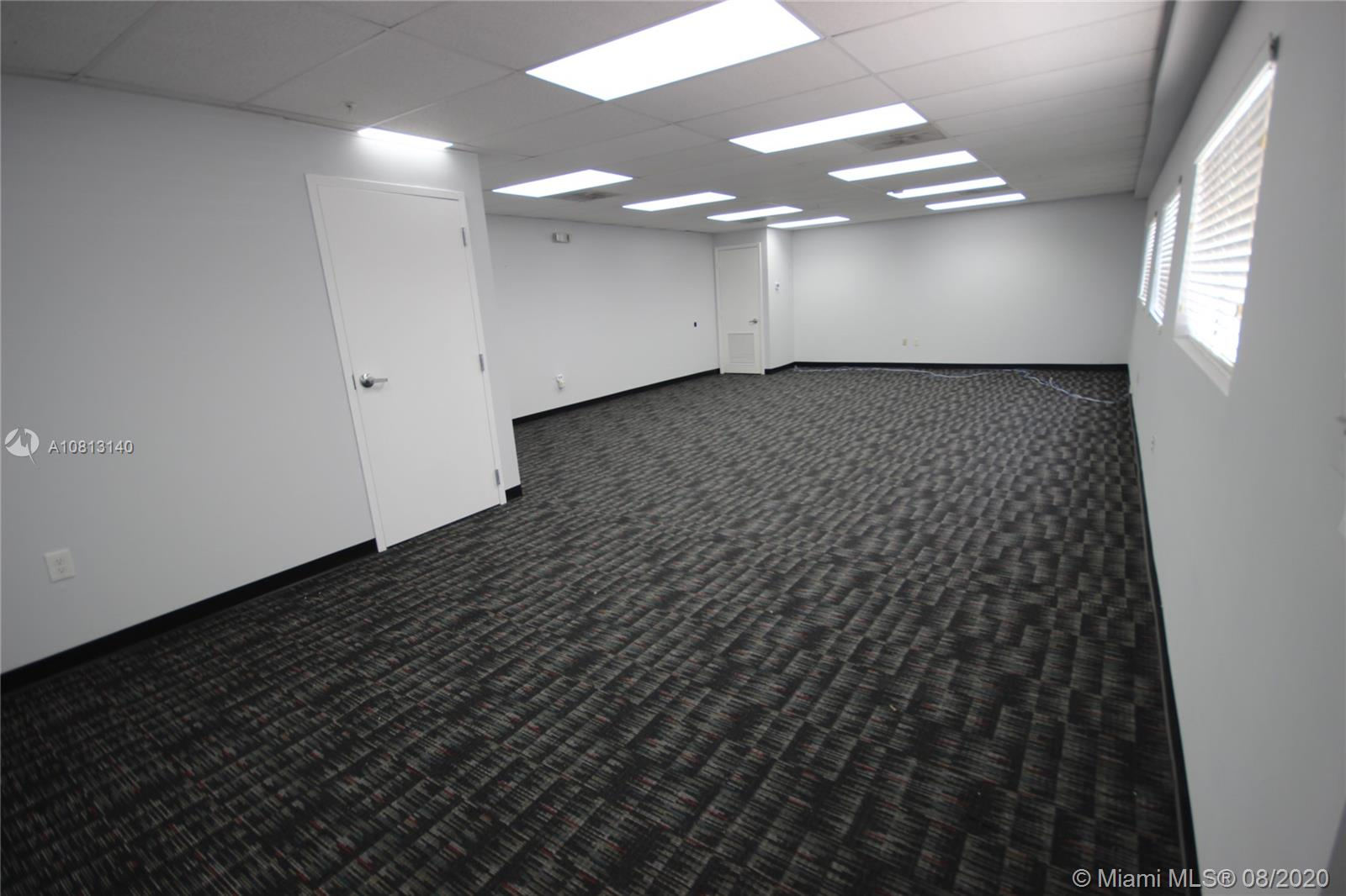 Bottom floor office area +/-800sqft.  New flooring and paint.  Secured, private entrance to office with shared use of bathroom and kitchen.  Located in an excellent location just minutes away from the Turnpike, Dolphin Mall and Miami International Mall.  Includes water, electricity, security service, internet and 3 assigned parking spaces.