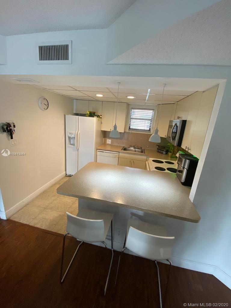 BEAUTIFUL CONDO LOCATED NEAR DOWNTOWN DORAL! WELL MAINTAINED, NO CARPET UNIT, WITH  GREAT LOCATION! WASHER AND DRIER INSIDE THE UNIT. EASY ACCESS,CLOSE TO MAJOR HIGHWAYS.COMMUNITY HAS POOL, FITNESS CENTER, TENNIS COURTS, AND 24 HOURS SECURITY.