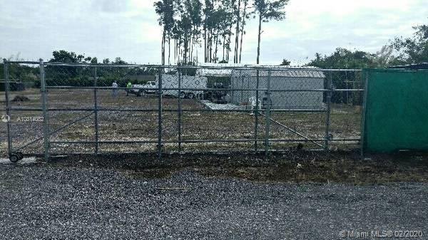 Next to privately owned homes.Land 42,689. sq. ft. with many upgrades ready. BUILD HERE 19570 SW 332 Street, Homestead, FL 33034, Unincorporated Miami-Dade County.Blocks from Robert Is Here Fruit Stand, minutes from Walmart, gas station, banks, Dollar stores, ect.Fully fenced double gated lot, lots of parking area.Utilities: electric, water, water-well, drainage, irrigation syst. - sprinklers.Cages, carp[orts, sheds, etc.large cement slab, tented structures, storage with A/C.Gates closedsale price firm: $174,000.