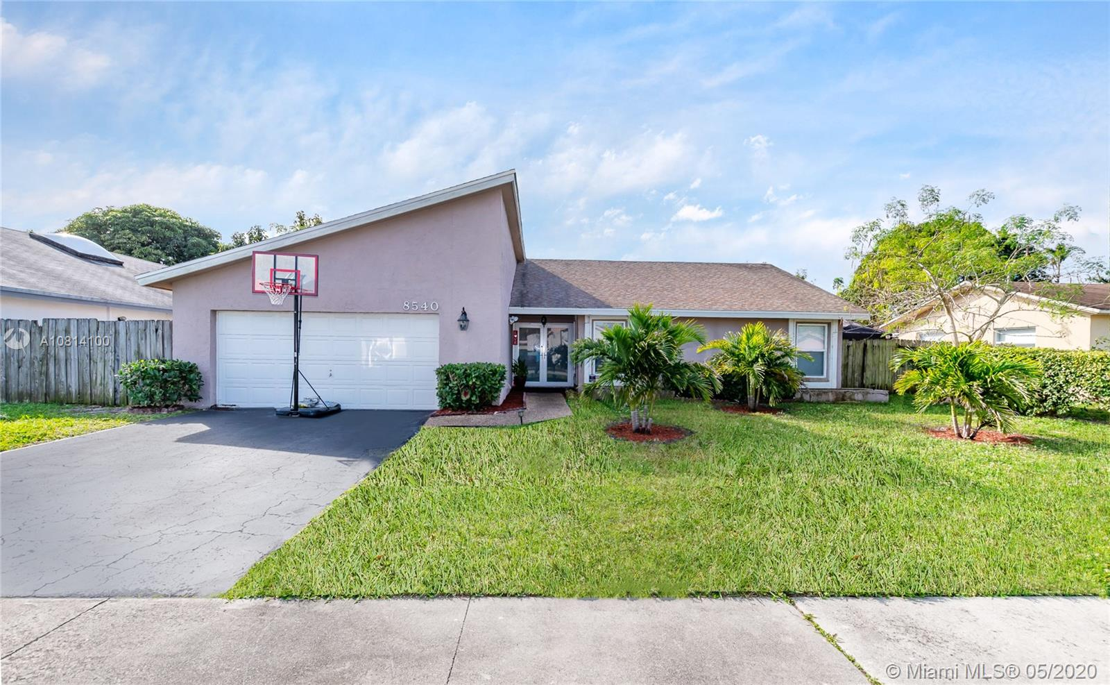 Beautiful 4 bedroom home in excellent neighborhood. Minutes away from excellent schools. Recently remodeled throughout. Large pool, Stainless steel appliances, wood floors, hurricane windows and doors. Garage has been converted into large 4th bedroom. Very easy to show!