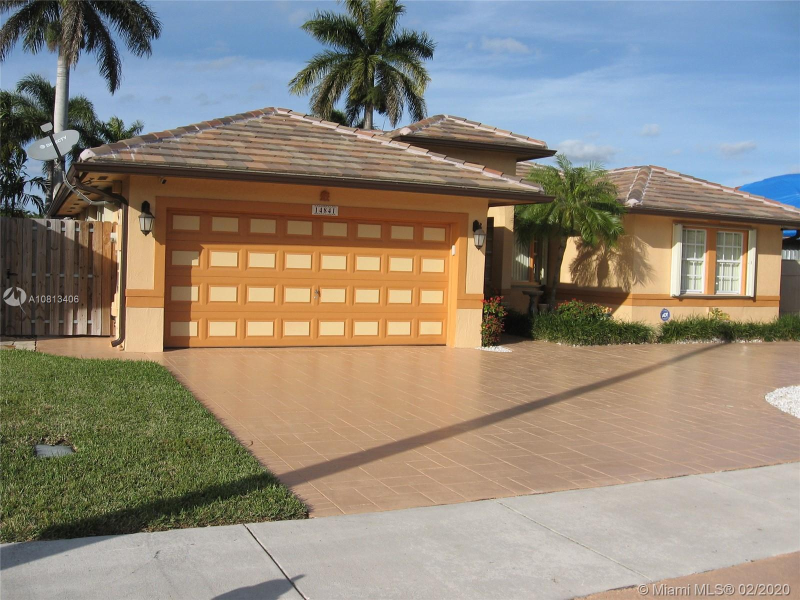 Spectacular 4 bedroom, 2 bath, two-car garage home located in a very desirable & quiet community in the SW Miami area. Close and accessible to highways, shopping centers, hospitals, etc. No HOA! Features photocell illumination throughout, high grade accordion shutters, full security camera  network ready, huge backyard with a 15x30 pool, beautifully designed full stamped concrete driveway, high ceilings, ceramic floors throughout, freshly painted. This home comes with an extra exceptional value with its 6 month old premium tile roof, less than a year old RHEEM full A/C system. BOTH items have a 10-year warranty. Great opportunity to own an impeccable home! Competitively priced! WON'T LAST!
