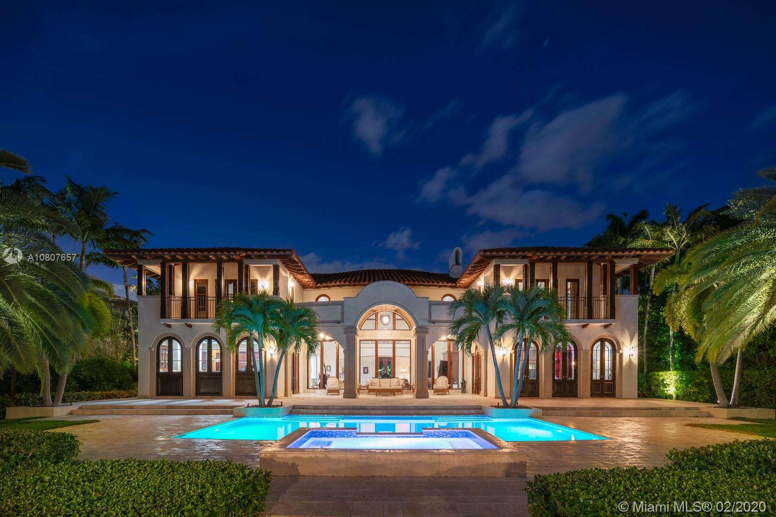 Combining an Italian villa with modern sophistication, this south-facing waterfront masterpiece is the premier setting for entertaining. The heart of the home is the great room featuring a grand marble entrance, mahogany wood details, vault and arched ceilings, & vast natural flowing light. A home of fine taste and opulent design, the floor to ceiling windows greet you with stunning 117 feet of waterfrontage & panoramic views of Indian Creek Golf Course and open waters. This 9,251 sf, 5BR/5+3BA property boasts 2 master suites, gourmet kitchen, formal dining room, elevator, ample storage throughout and an expansive patio area with a brand new private boat dock, remodeled pool, raised sea wall & outdoor generator. This residence offers some of the most breathtaking views in all of bay harbor