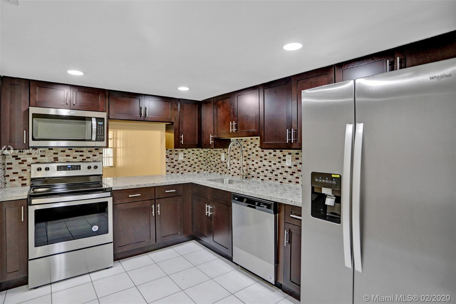BEAUTIFUL GATED 2/2.5 CORNER UNIT TOWNHOUSE. NEW KITCHEN CABINETS & GRANITE COUNTER TOPS, WHIRLPOOL SS APPLIANCES, UPGRADED BATHROOMS. NEW LAMINATE FLOORING, CLOSET DOORS, SMOKE DETECTORS,CEILING FANS, WINDOW TREATMENTS,OUTLETS & SWITCHES & INTERIOR PAINT. TWO MASTER BEDROOMS & HUGE WALK IN CLOSET. ROOFTOP TERRACE. ONE OF THE NICEST UNITS IN THE AREA. NEW W/D BEING INSTALLED.  HOA FEE INCLUDES ROOF REPAIRS.  NEW INCOMING IMPROVEMENTS: NEW ACCESS ROAD,TENNIS COURTS. YEAR ROUND HEATED SWIMMING POOL, SAUNA, GYM & YOUTH PLAYGROUNDS. SEE BROKER REMARKS!  RING ALARM SYSTEM & CAMERAS DO NOT CONVEY.