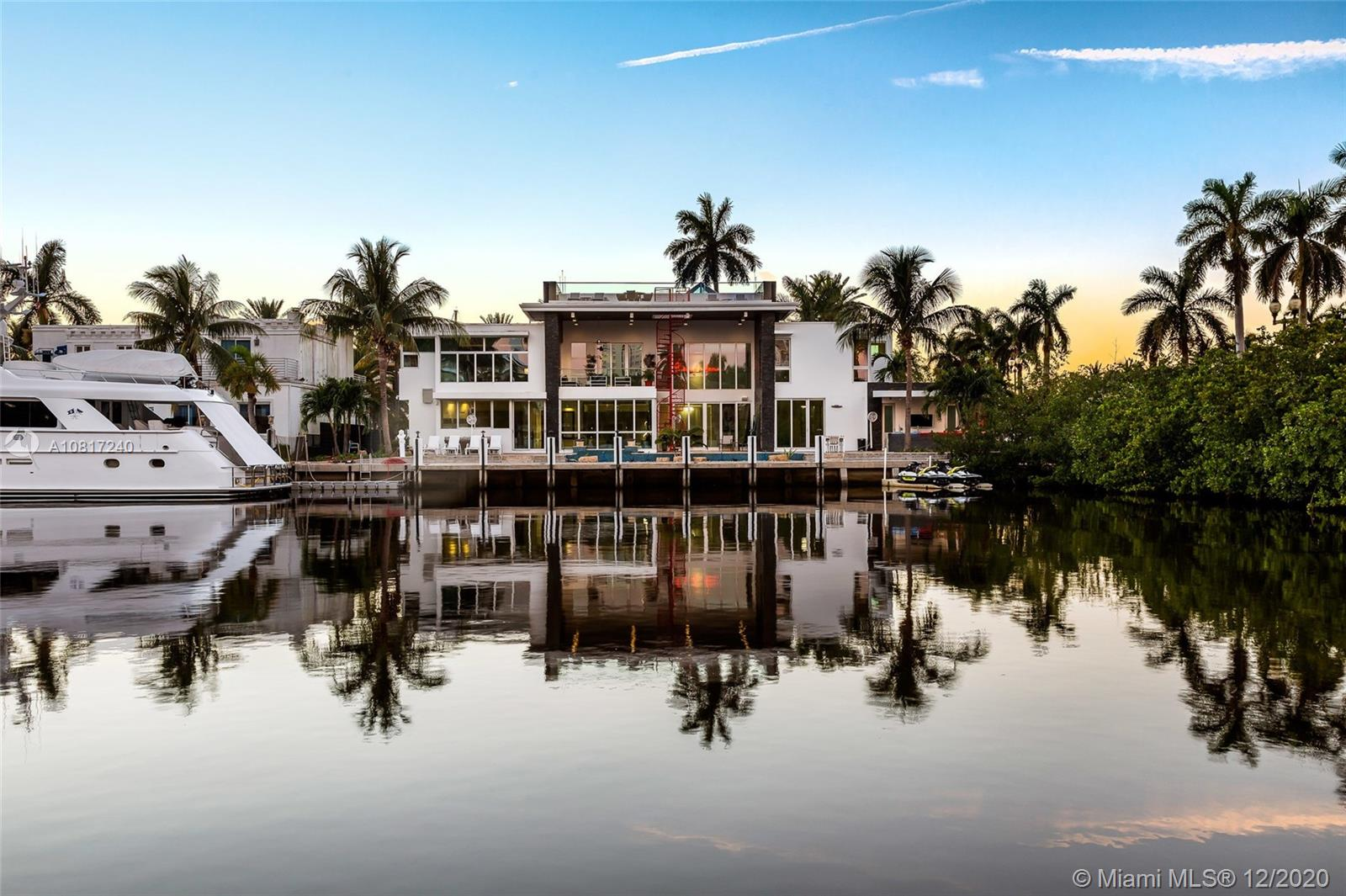 Weekly rental price $17,500! Luxurious 7 bedrooms + 7.5 bathrooms with a custom-designed modern luxury residence with brand new Italian furniture on a wide canal in the Las Olas Isles, w/160' water frontage on the wide canal & turning basin. Dock 100' yacht. Top-of-line chef's kitchen, gas fireplaces, elevator, integrated lighting & sound systems, pyramid skylight, impact windows, 4 A/C units, motorized blinds, an outdoor oasis with a beautiful rooftop deck w/artificial grass. Walking distance to restaurants and beach. Please note that the price shown is a weekly price. We can give a discount if inquiring about a monthly price.
